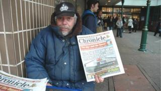 Brian Howard selling papers at the Grosvenor Centre in Northampton