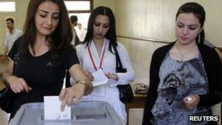 Syrian women vote in the parliamentary elections on 7 May 2012