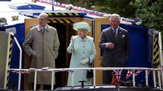 The Queen, Duke of Edinburgh and Prince Charles on a barge in Burnley