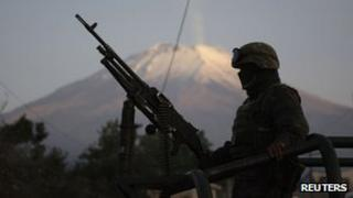 A soldier on patrol in Mexico