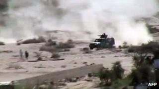 An image taken with a mobile phone allegedly shows an armed vehicle driving in Lawdar, in the restive southern Abyan province, as clashes continued between Al-Qaeda militants and the Yemeni army forces on Wednesday
