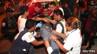 Inmate being carried out of a jail in San Pedro Sula