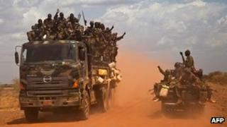 South Sudan People's Liberation Army vehicles drive on the road from Bentiu to Heglig, on April 17, 2012.