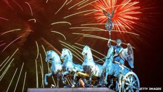 Fireworks illuminate the Brandenburg Gate