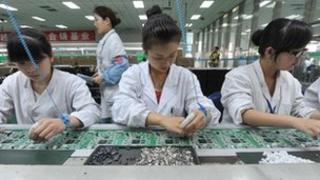 Chinese workers assembling circuit boards at a factory in Mianyang, Sichuan province