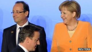 David Cameron passes Francois Hollande and Angela Merkel at the Nato summit in Chicago, 20 May