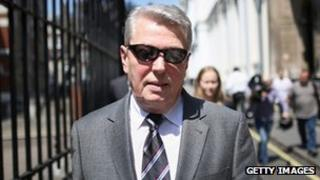 Former home secretary Alan Johnson leaves the Leveson Inquiry