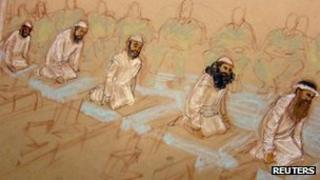 The five men accused of plotting the 9/11 attacks pray at their arraignment hearing Guantanamo Bay, Cuba 5 May 2012