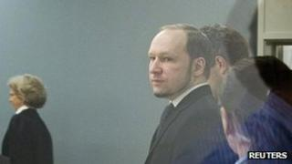 Anders Behring Breivik arrives in court on 24 May 2012, with judge