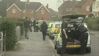 Police and passers-by during police operation in Filwood, Bristol