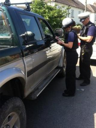 Officers speaking to a motorist stopped in Dorchester on Wednesday