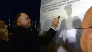 Alex Salmond signs the declaration