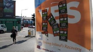 A poster supporting the EU fiscal treaty is defaced by anti-EU stickers at a crossroads in Dublin