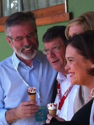 Sinn Fein president Gerry Adams enjoys an ice-cream with party representatives