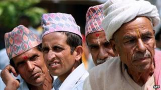 Nepali men wearing the traditional caps