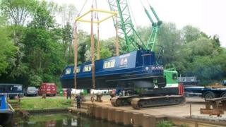 Diamond narrowboat being placed back into the canal in Watford