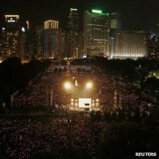 People attend a candlelight vigil marking Beijing's 1989 Tiananmen Square crackdown at Hong Kong's Victoria Park, 04 June, 2012