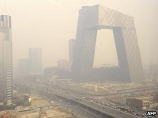 The new China Central Television headquarters building is covered in haze in Beijing in March