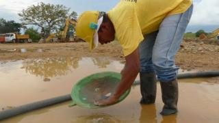 Worker in an illegal gold mine in a farm in Caucasia, Colombia