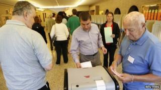 Voters cast their ballot in the special recall election in Wauwatosa, Wisconsin 5 June 2012