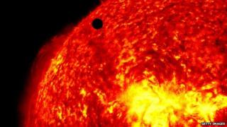 Venus seen as a black dot moving across the sun