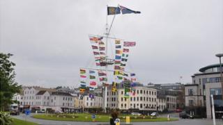 Commonwealth flags on Guernsey's memorial mast