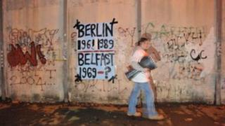 Drummer at the peace wall in Lanark way in a cross community event on the anniversary of the Berlin wall being knocked down