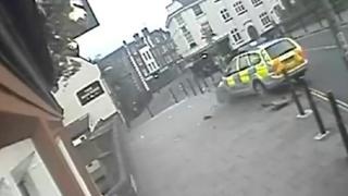 Police car crashing through roadside bollards in Norwich