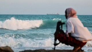 A Somali pirate keeping vigil near Hobyo, in Somalia - archive shot