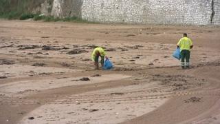 Beach cleaners on a beach in Thanet