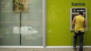 A file picture taken on May 17, 2012 shows a man using a Bankia ATM machine in Madrid.