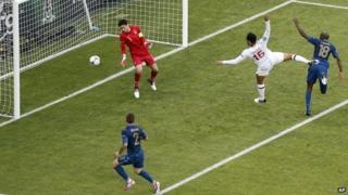 England's Joleon Lescott scores the opening goal past France goalkeeper Hugo Lloris.