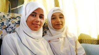 Sharifah binti Hussein (L), with a friend