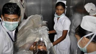 An injured employee of the steel plant is being taken to a hospital in Visakhapatnam