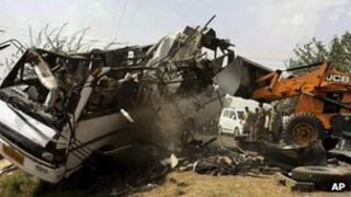 The wreckage of a passenger bus which collided with another in India on April 29, 2012