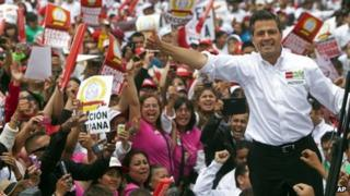 Mexican presidential candidate Enrique Pena Nieto of the Revolutionary Institutional Party (PRI) waves to the crowds during a campaign stop in the northern border city of Tijuana, Mexico, 3 June