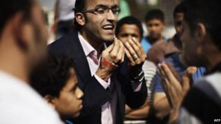Egyptians argue about politics in Cairo's Tahrir square
