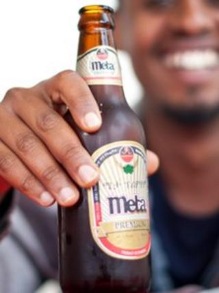 Man holding a bottle of Meta beer