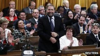 NDP leader Mulclair votes during omnibus bill
