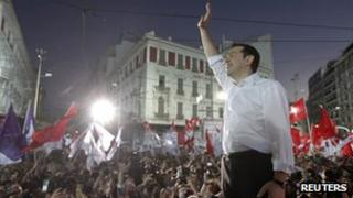 Alexis Tsipras, the head of Greece's leftist Syriza party, waves at supporters during a pre-election rally in Athens June 14 2012