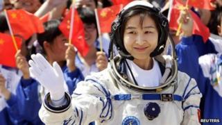 Liu Yang waves during a departure ceremony at Jiuquan Satellite Launch Center, Gansu province, June 16, 2012