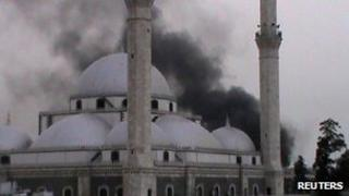 A handout image released by the Syrian opposition's Shaam News Network on June 16, 2012 allegedly shows smoke rising from a mosque following shelling by government forces on the Khalidiyeh neighbourhood of the restive central city of Homs