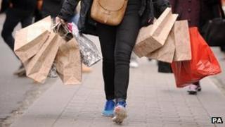 A woman carrying shopping bags
