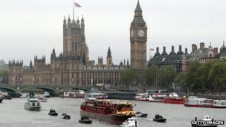 Houses of Parliament seen behind the Jubilee Pageant on the Thames