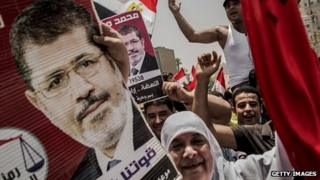 Supporters of Muslim Brotherhood candidate Mohammed Morsi celebrate his claiming victory in Cairo's Tahrir square on 18 June 2012