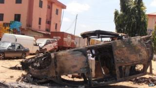 A car vandalised by Christians in Kaduna on 17 June in a reprisal attack for the bombing of churches by Islamist militant group Boko Haram on Sunday