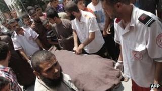 Medics move the body of Ghalib Armilat in Rafah (20 June 2012)