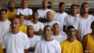 Gang members attend Mass in prison of Izalco, about 65 km (40 miles) from San Salvador 19 June 2012