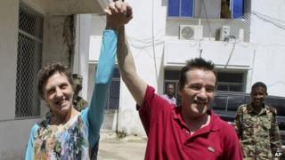 Deborah Calitz and Bruno Pelizzari outside the presidential palace in Mogadishu after being freed from their Somali pirate captors