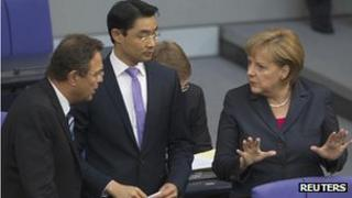 Chancellor Angela Merkel (right) with ministers in parliament - file pic